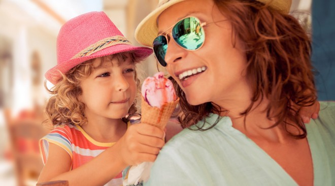 Mother and Daughter Share Ice Cream Cone at Barefoot Landing